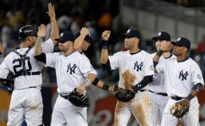 The Yankees celebrating after a 6-4 victory over the Orioles.