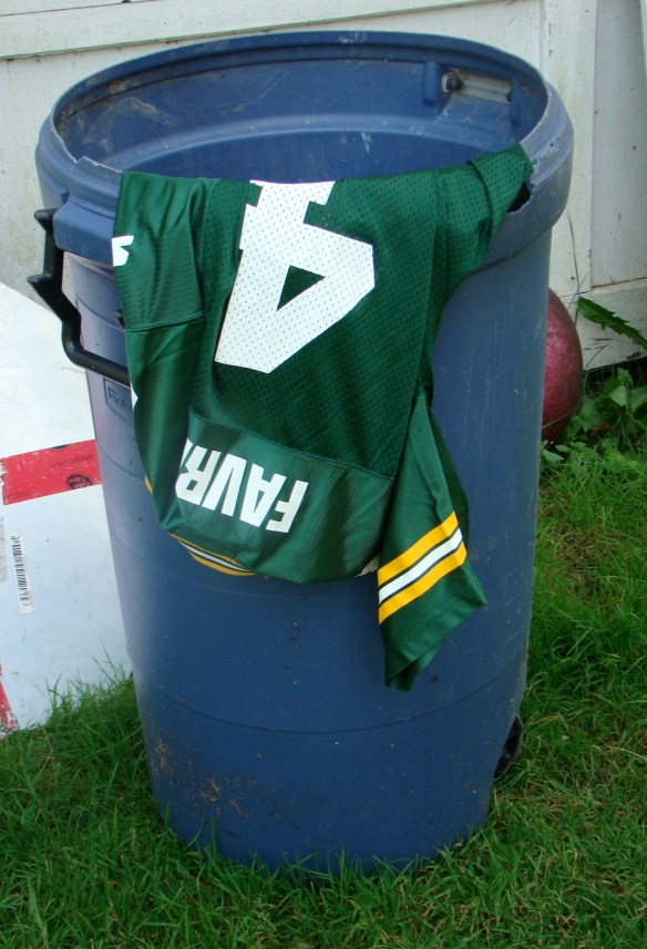 My Favre jersey enjoys a new place of honour...in the Bee family garbage can. Trash goes out Wednesday, y'all!