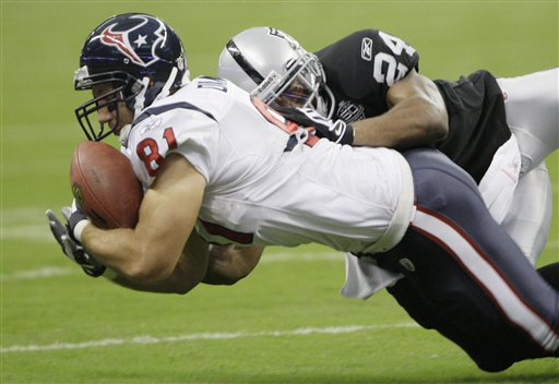 Texans 29, Raiders 6. Owen Daniels' booty gets a hug from Huff!