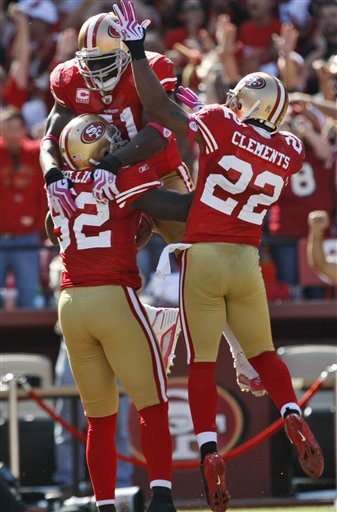 49ers 35, Rams 0. Here's a duo of shutout booties from Patrick Willis and Nate Clements (with non-booty shower and my former love Takeo Spikes!!!)
