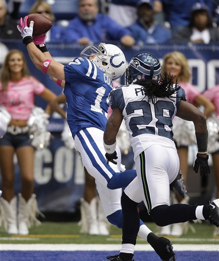 Colts 34, Seahawks 17. Travis Fisher's booty can't catch Austin Collie's!