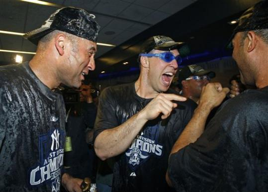 I know this is from when the Yanks won the division, but I add to include it. The look on Tex is classic.