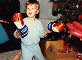 No, he's not a boxer, but the gloves are a hint
