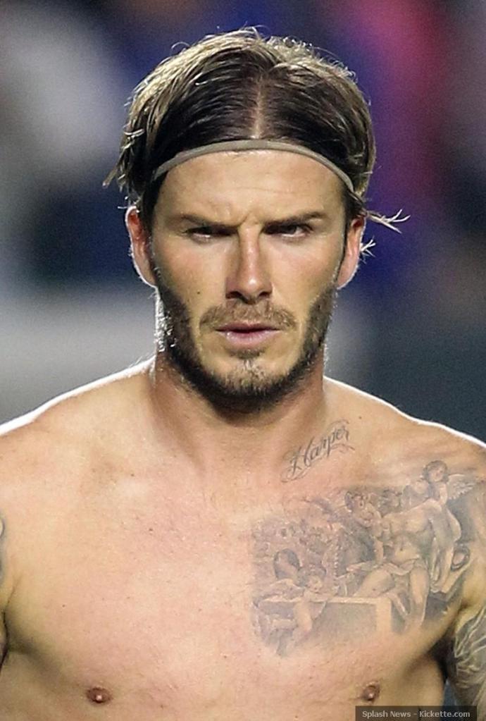 david-beckham-harper-tattoo-side-eye-football-1085826077